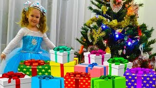 Peek A Boo Song Little Baby Liza playing hide and seek with a Christmas tree and gifts