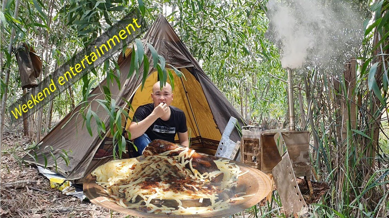 Bushcraft , camping and cooking young beef ribs to eat with noodles - my food style .