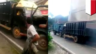 Idiot truck drivers smash head on as both refuse to back up on narrow road   TomoNews