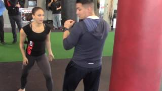 "Michelle ""Karate Hottie"" Waterson breaks down how to use kicks to break down & KO your opponent"