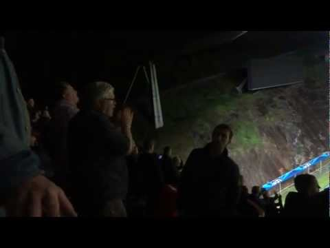 United fans at away sector of Braga stadium during lights stop