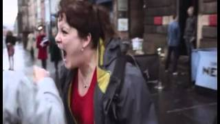 Moment woman SCREAMS at man when he tries to give her money