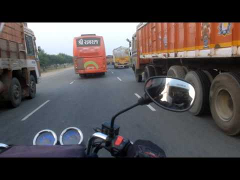 Overtaking by a motorcycle on indian road NH8