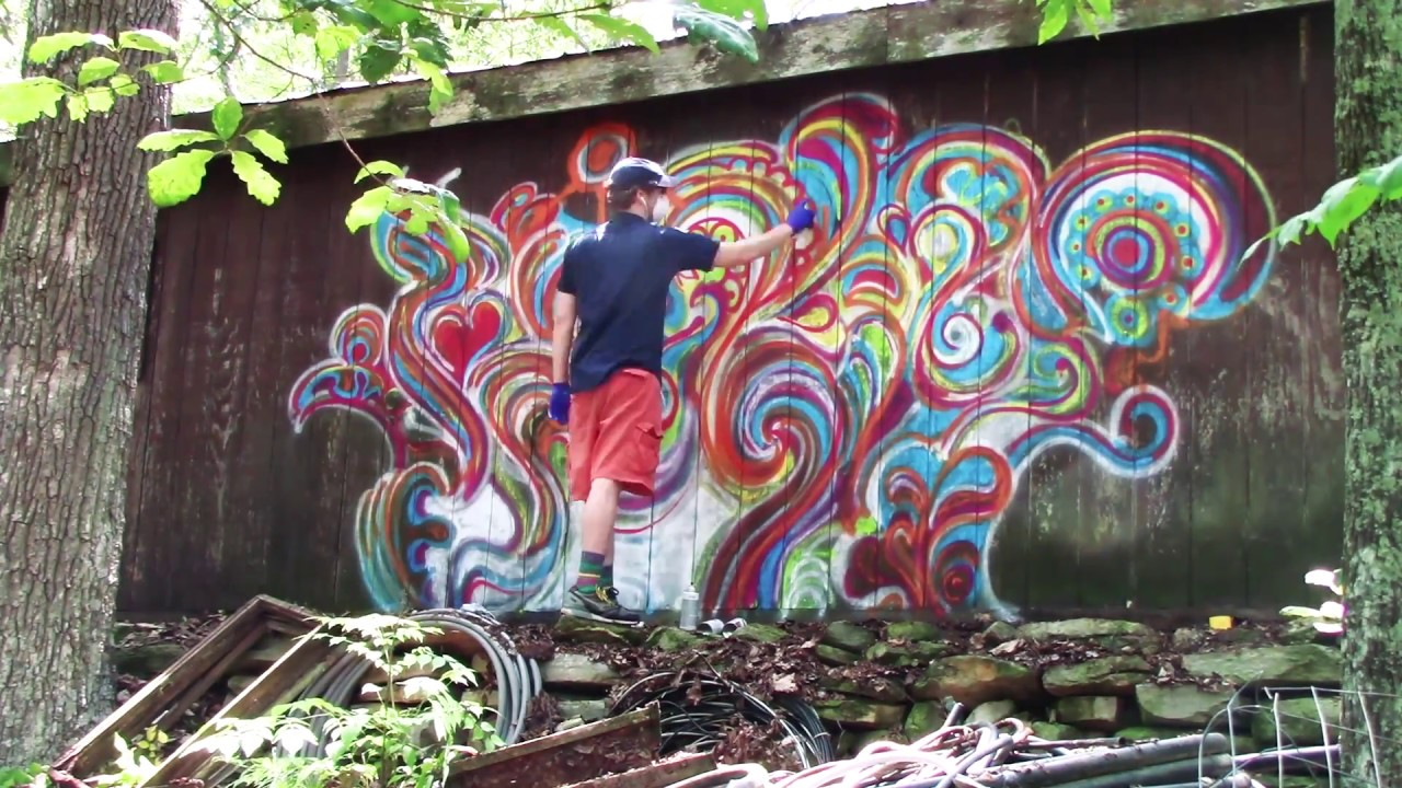 spray paint swirl art on a wall (graffiti? doodling with spray paint