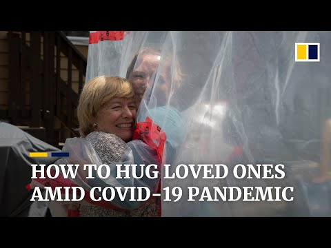 Canadian invents 'hug glove' to embrace loved ones amid Covid-19 pandemic