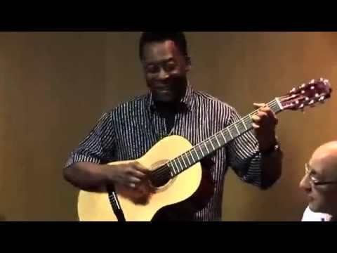 Pele The Brazilian Player Plays Guitar During UK Charity Visit