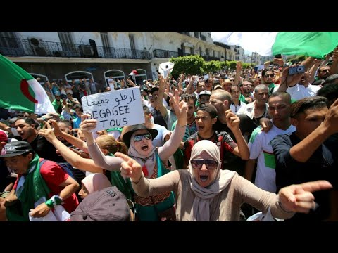 Braving police and heat, Algerians take to streets pressing for real change