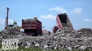 Two Colt Dump truck Unloading ton of Rock