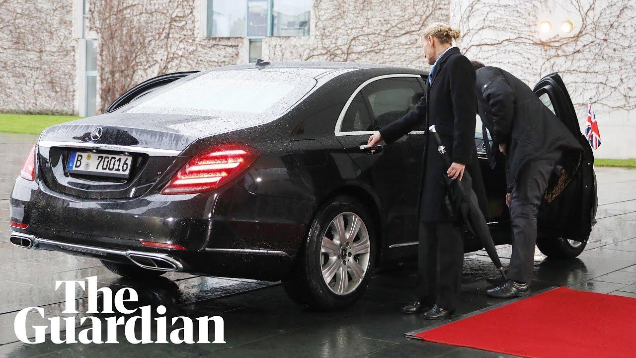 Theresa May gets locked inside her car as she arrives to meet Angela Merkel
