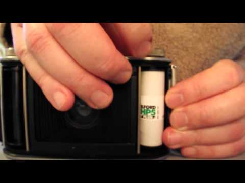 "Loading Ilford 120 roll film into an Ensign ""Ranger II"" medium format camera"