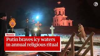 Vladimir Putin takes icy plunge to mark Orthodox Epiphany