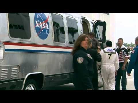 STS-135 Crew Suitup and Walkout