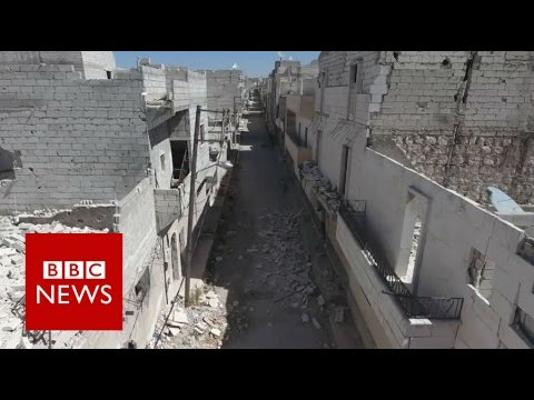 Aleppo damage revealed by haunting drone video - BBC News