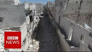 Aleppo damage revealed by haunting drone video - BBC News(Drone footage reveals a badly damaged area once inhabited by 200 families. Only two remain and we got to speak to one of them. Please subscribe HERE ..., 2016-09-27T17:40:11.000Z)