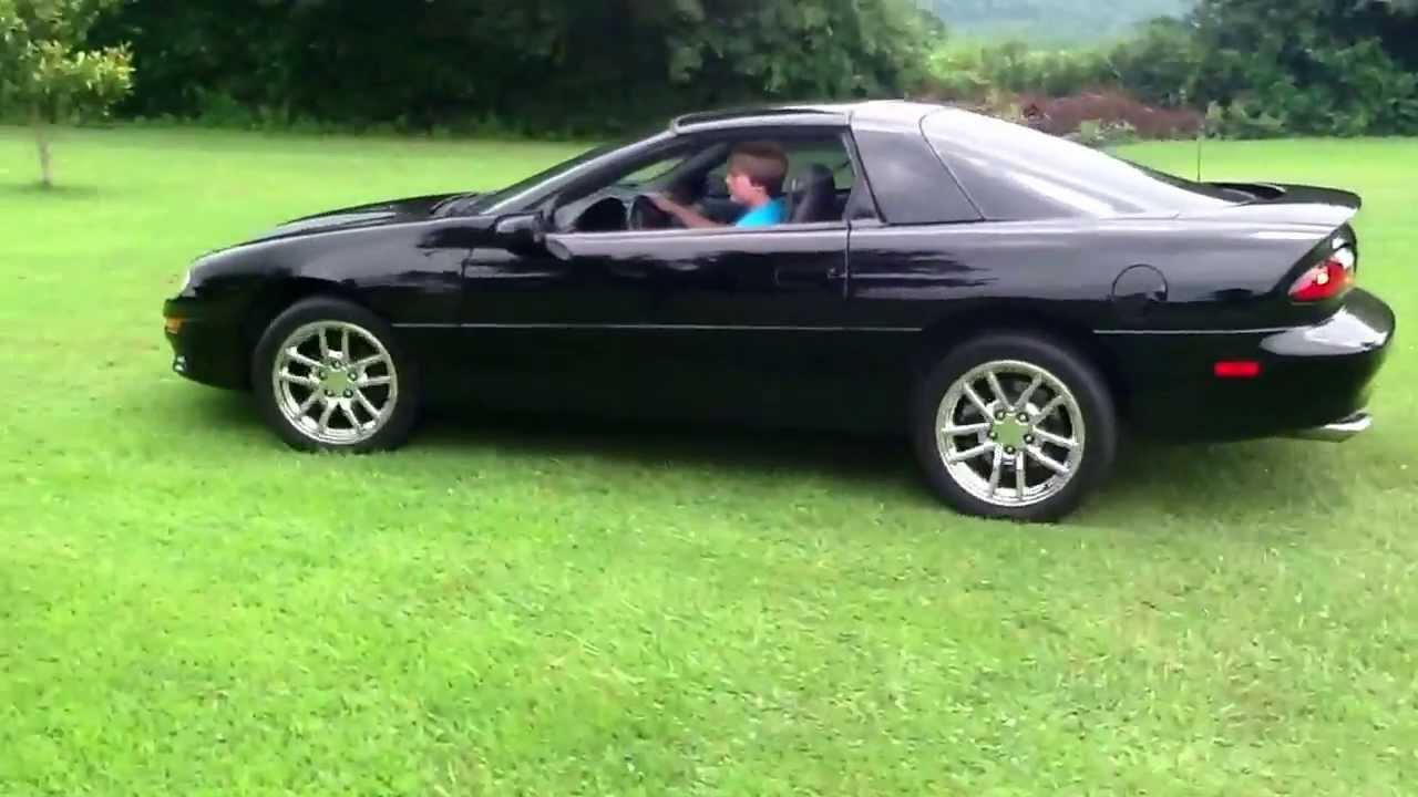 Me driving a 1999 camaro z28 v8 engine chrome wheels flow master