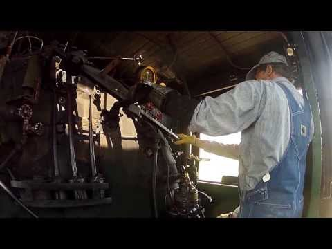 My dad behind the throttle of a steam locomotive in (part 2)