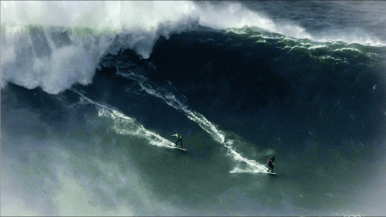 BIGGEST WAVE ever ridden by 2 Surfers - Nazaré, Portugal // 2017