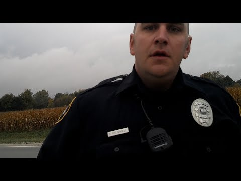 Sycamore IL Police officer doesn't like video cameras.