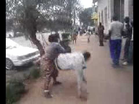 Download Wife Beats Up Irresponsible Husband, Africa-style (Slaps and Judo moves)