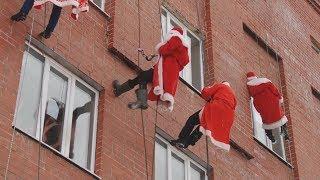 5 Дед Морозов десантировались с крыши в детскую клинику. Real video