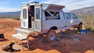 Minimalist Pilot sells Slide In Camper to Build a Stealth Diesel Solar Camper - Truck Walk Through