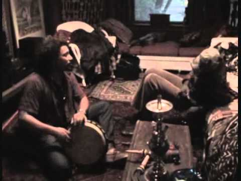 Thomas playing a Djembe Drum with friends in Chicago