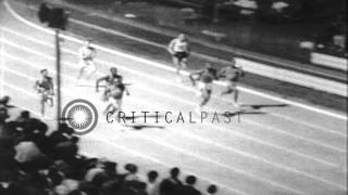 Tommie Smith wins 220 yard dash and Jim Hines of Southern Texas wins100 meter das...HD Stock Footage