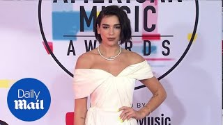 Nailed it! Dua Lipa rocks nail inspired necklace at 2018 AMAs