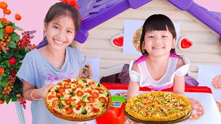 Nora Opens Pizza Restaurant