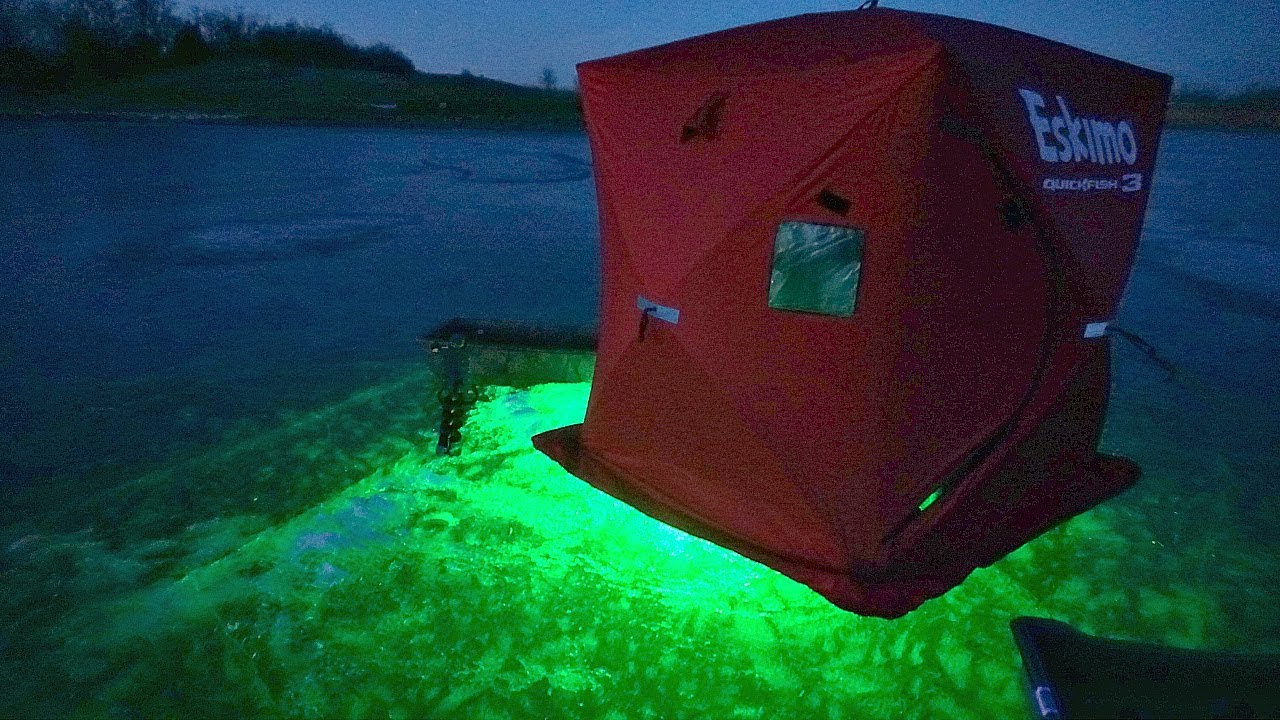 Insane ice fishing w glow lights at night youtube for Ice fishing at night