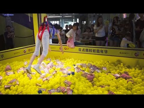 Too much fun: Big claw machines using man as claw