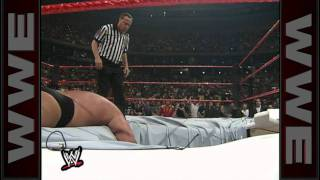 Big Show chokeslams The Undertaker through the ring