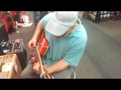 Awesome Eric jamming guitar at a music store