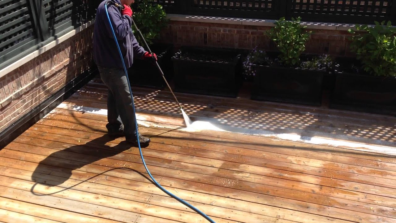 Power washing a deck - Rooftop Deck Pressure Washing Company Chicago