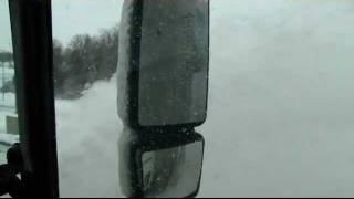 how do you drive safely around snowplows
