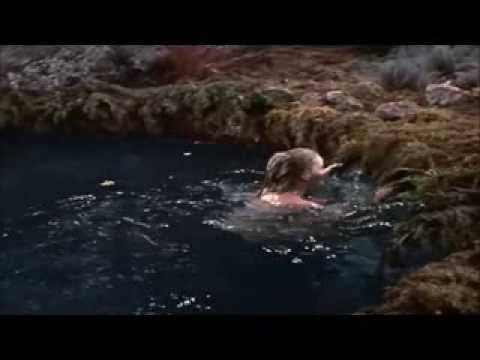 forbidden planet : anne francis gets out of a pond