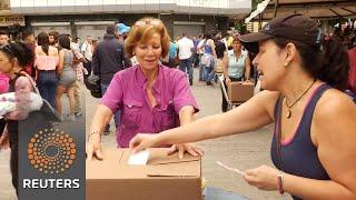 Venezuelan's vote in unofficial poll, in defiance of Nicolas Maduro