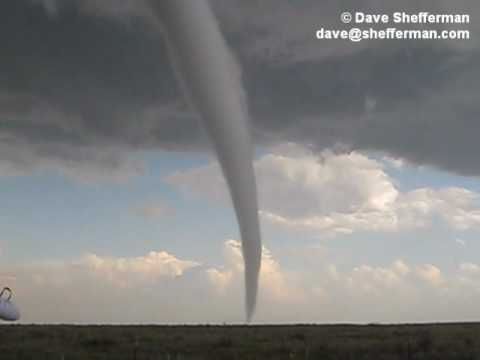 Awesome footage of tornado forming and touching ground