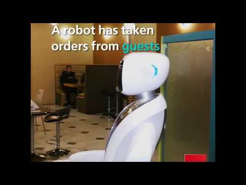 A Robot from Japan Serves Customers at a Kabul Restaurant
