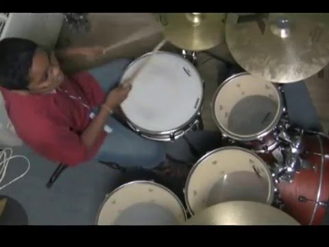 JEROME CHARLES AT 9 YEARS PLAYS AN AMAZING DRUM SOLO