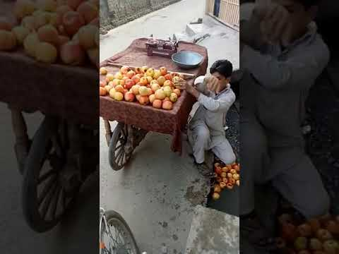 Fruit seller cleaning apples in dirty water..