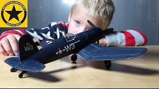 scale model f4u corsair assembled by 3 year old jack
