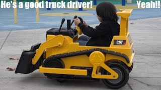 Construction Toy Trucks: Driving a Caterpillar Bulldozer Ride-On at the Playground