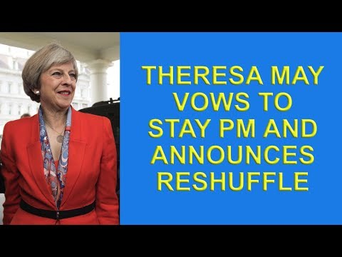 Theresa May vows to continue as PM