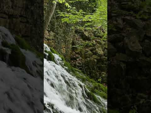 Vertical video. Waterfall flows from Yusupov lake. Crimea
