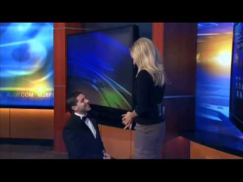 Boyfriend surprises weather girl with surprise proposal - on live TV