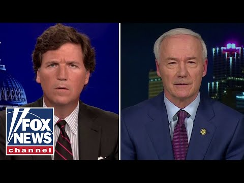 Tucker clashes with Arkansas governor over youth gender reassignment bill