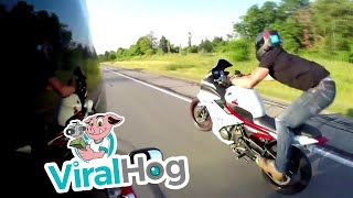 Ridiculous Wheelie Turned into Road Rash in a Flash || ViralHog