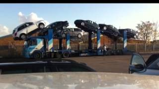 Unloading 11+ car transporter in Milton Keynes
