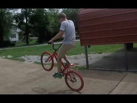 how to pop a wheelie on a BMX bike